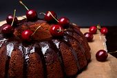 pic of black-cherry  - Delicious chocolate cake with glaze and cherries on the black background - JPG