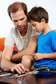 involved father helps son with puzzle