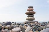 Zen Stones balance, pebbles stack over blue sea