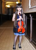 Portrait Of A Little Girl With A Violin