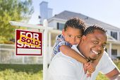 picture of mixed race  - African American Father and Mixed Race Son In Front of Sold Home For Sale Real Estate Sign and New House - JPG