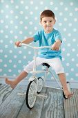 little boy on a bicycle in the room