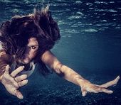picture of sportive  - Closeup portrait of attractive woman underwater - JPG