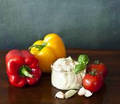 Hummus With Peppers, Tomatoes And Garlic