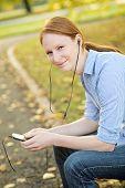 Woman Enjoying Music In A City Park