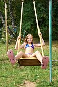 picture of swing  - Girl swinging on a swing in park outdoor - JPG