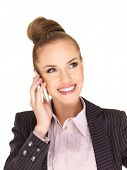 Elegant woman with her hair up in a bun wearing a stylish jacket talking on her mobile phone looking upwards with a smile  over white