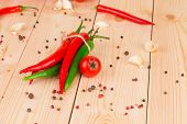 Red hot chili peppers on wood table.