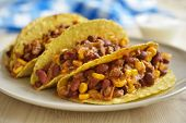 Three tacos with chili con carne