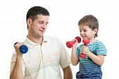 father and kid son doing exercise with dumbbell together