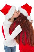 Festive mother giving daughter a hug on white background