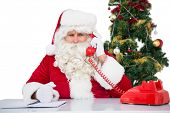 Irritated santa claus on the phone on white background
