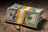pic of 100 dollars dollar bill american paper money cash stack  - Creative business finance making money concept  - JPG