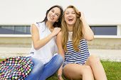 Beautiful and happy teenage students in the school