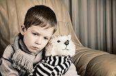 Tinted Image Sad Little Boy Hugging Toy Dog