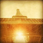 View of Eiffel Tower at sunset in grunge style.