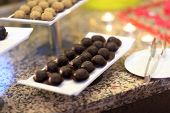 pic of cake-ball  - Chocolate ball cakes on the tray at the buffet - JPG