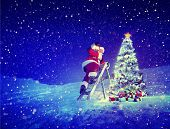 Santa with lamp on a step-ladder by the christmas tree.