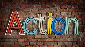 Action Word and Brick Wall in Background