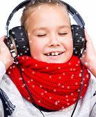 Girl Is Enjoying Music Using Headphones