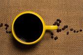 Coffee Mug Closeup - Top View With Beans