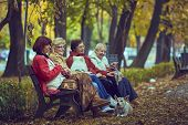 Retired Women On A Bench