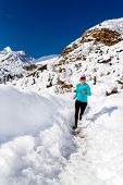 Happy Woman Cross Country Running In Winter