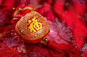 Chinese new year decorations, lucky bag on red background. The Chinese character means