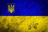 stock photo of trident  - Flag and Coat of Arms Trident of the Ukraine on Grunge Concrete Wall Texture - JPG