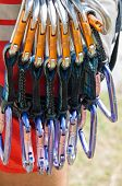 stock photo of shackles  - particular of some colored shackle for climbing - JPG