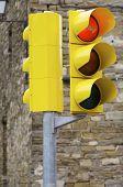 Closeup of a yellow traffic light.
