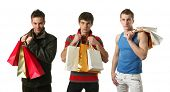 Three young sexy men with copy space shopping bags isolated on white