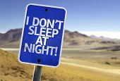 I Don't Sleep At Night sign with a desert background