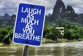 Laugh As Much As You Breathe sign with a exotic background