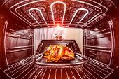 foto of roast duck  - Chef prepares roast chicken in the oven - JPG