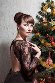 Beautiful woman with Christmas tree