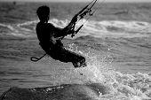 foto of kites  - healthy active man enjoying  kite surfing in Vietnam - JPG