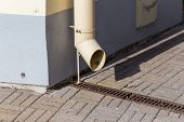 picture of gutter  - old gutter metal rain drain pipe on the wall - JPG