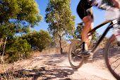foto of dirt-bike  - Mountain bike racer zooming past with motion blur - JPG
