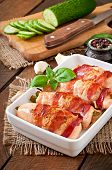 picture of bacon strips  - Delicious chicken rolls stuffed with green beans and carrots wrapped in strips of bacon - JPG