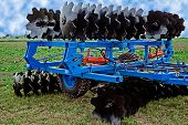 foto of cultivator-harrow  - Equipment for agriculture presented to an agricultural exhibition - JPG