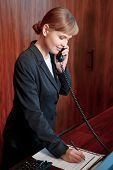 picture of receptionist  - Booking confirmed - JPG
