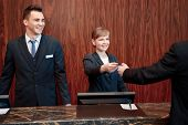 picture of receptionist  - Here is your key - JPG