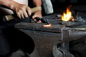 image of blacksmith shop  - blacksmith forges iron in the forge - JPG