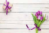 foto of purple white  - Purple tulips and gift box over wooden table - JPG