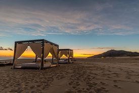 picture of cabana  - Cabanas on the beach ready for some relaxing  - JPG