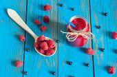 stock photo of mason  - Mason jar with raspberry jam or marmalade and fresh raspberries - JPG