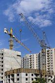 stock photo of construction crane  - Construction cranes and high - JPG