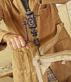 detail of caucasian carpenter at work with old vintage manual drill
