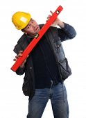 Male construction worker with spirit-level on a white background.